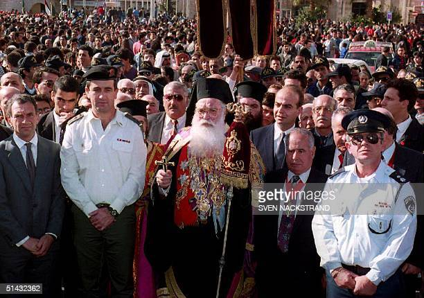 Greek Orthodox Patriarch Diodorous II flanked by Israeli Military Governor of Bethlehem Colonel Moshe Elad and Bethlehem Mayor Elias Freij lead the...