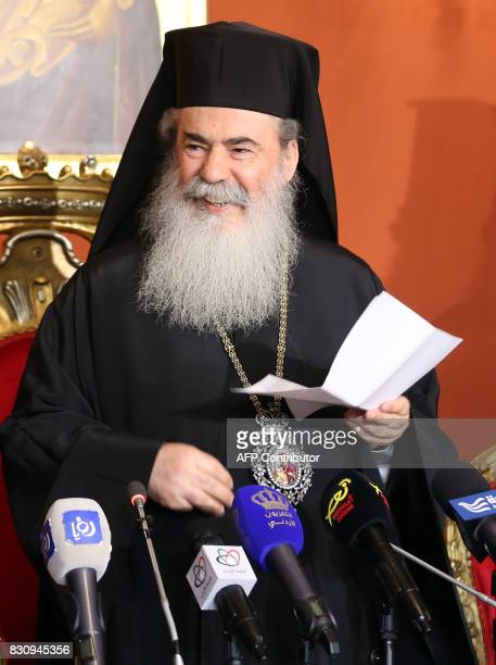 Greek Orthodox Patriarch of Jerusalem Theophilos III arrives for a press conference in the Jordanian capital Amman on August 12 2017 / AFP PHOTO /...