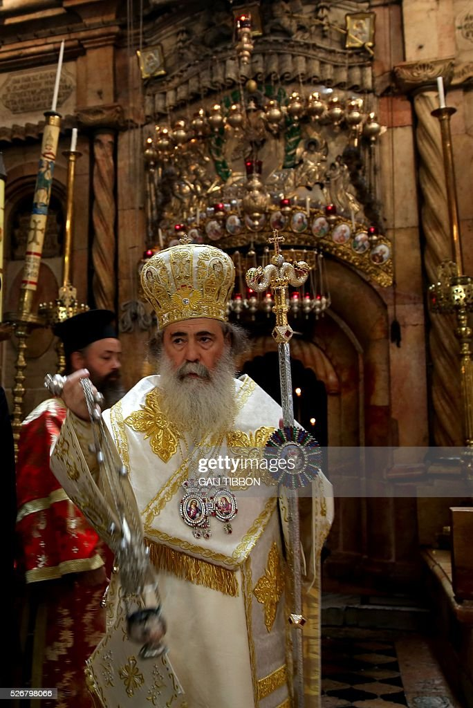 Greek Orthodox Patriarch of Jerusalem Theophilos III leads the Orthodox Easter Sunday mass at the Church of the Holy Sepulchre in Jerusalem's Old City on May 1, 2016 as Orthodox Christians celebrate the resurrection of Jesus. / AFP / GALI