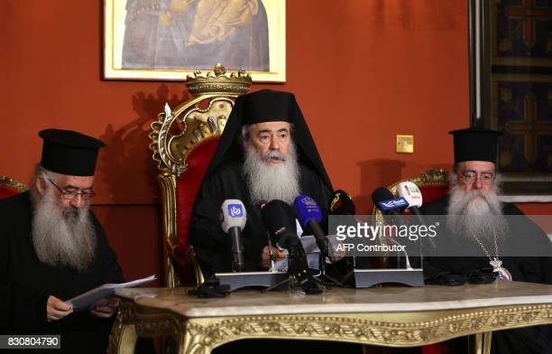 Greek Orthodox Patriarch of Jerusalem Theophilos III speaks during a press conference in the Jordanian capital Amman on August 12 2017 / AFP PHOTO /...