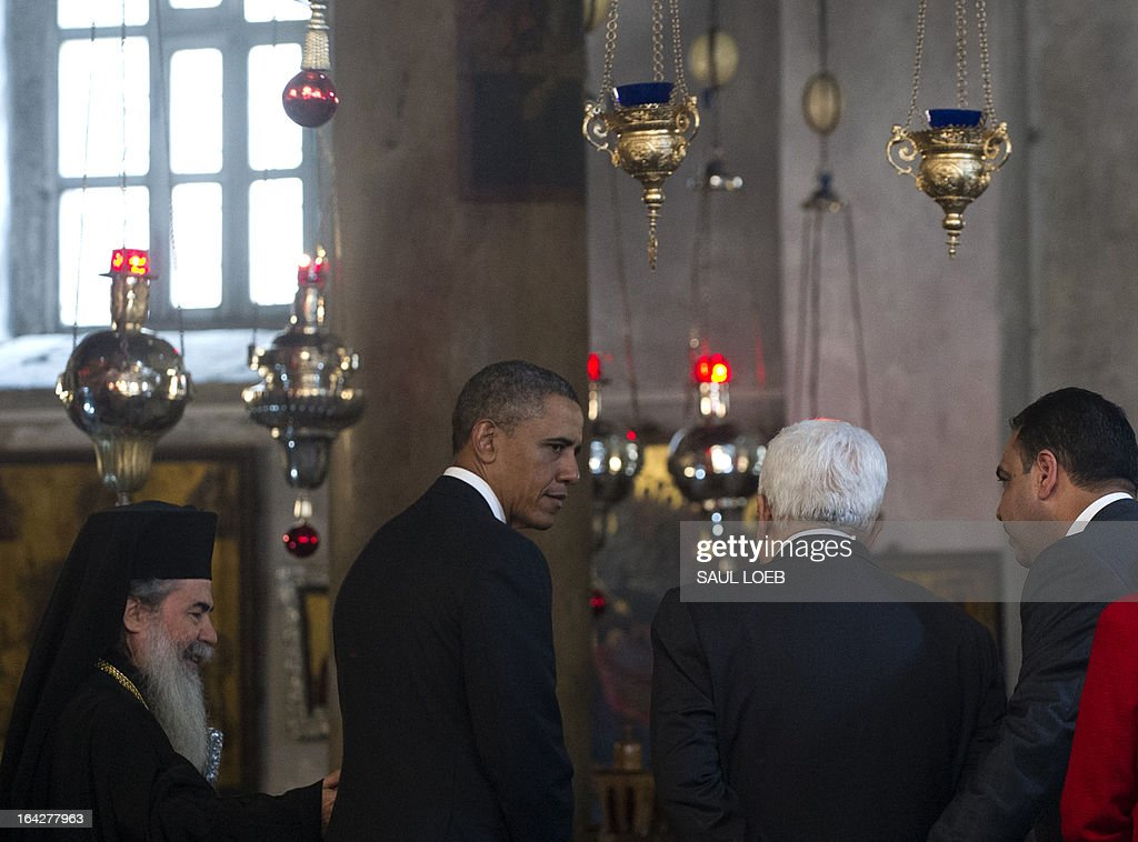 Greek Orthodox Patriarch of Jerusalem Theophilos III (L), US President Barack Obama (C) and Palestinian president Mahmud Abbas (2nd R) tour the Church of the Nativity, built on the site where tradition says Jesus was born, in the West Bank city of Bethlehem, on March 22, 2013, on the final day of Obama's 3-day trip to Israel and the Palestinian territories. AFP PHOTO / Saul LOEB