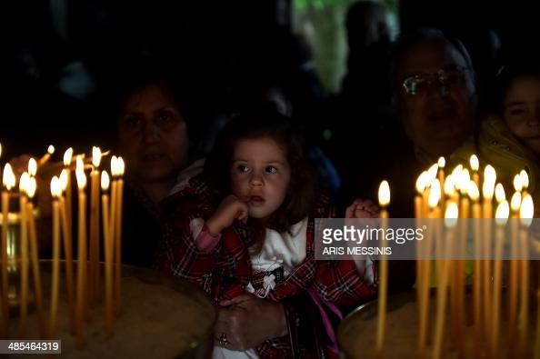 Greek Orthodox pilgrims light candles during the ceremony marking the Apokathelosis the removal of Christ's dead body from the Cross which forms a...