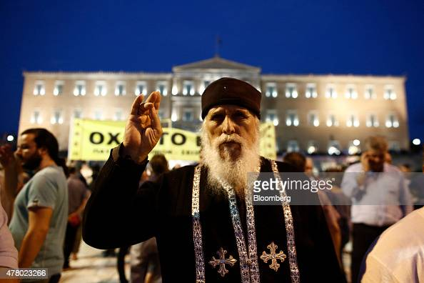 A Greek orthodox priest takes part in a rally at Syntagma square in front of the Greek parliament building in Athens Greece on Sunday June 21 2015...