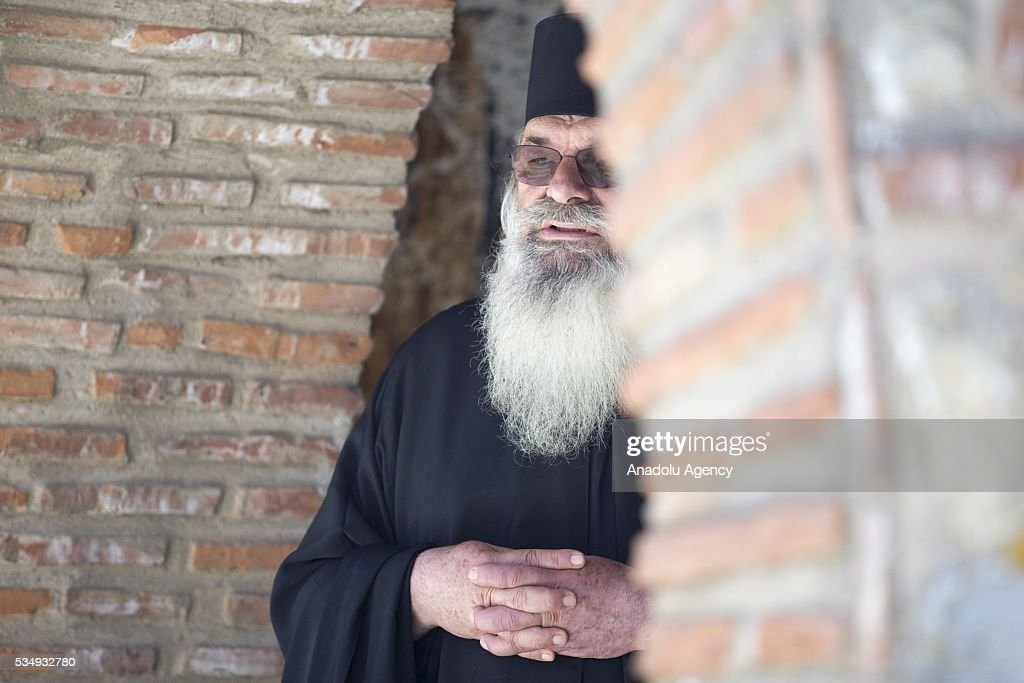 A Greek Orthodox priest waits before the visit of The President of Greece, Prokopis Pavlopoulos and President of the Russian Federation, Vladimir Putin in a monastry in Mount Athos, Greece on May 28, 2016.