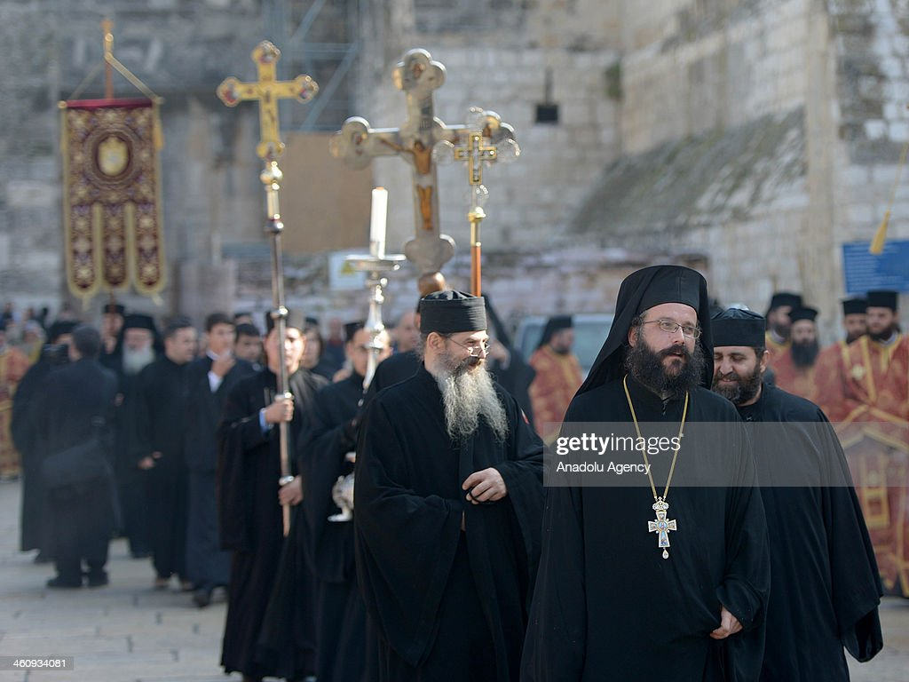 Greek Orthodox priests attend the Christmas mass at Nativity Church in Bethlehem, West Bank on January 6, 2014.