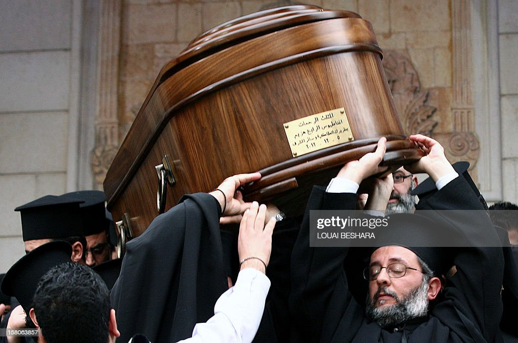 Greek Orthodox priests carry the coffin of Greek Orthodox patriarch of Syria, Ignatius IV Hazim, during his funeral at the Meriamiah Church in the Syrian capital Damascus on December 10, 2012. The patriarch died of a stroke in the Lebanese capital Beirut on December 5.