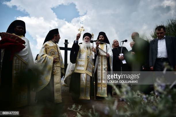 Greek Orthodox priests celebrate the 'Apokathelosis' the Descent of Jesus from the cross at the Penteli Monastery north of Athens on April 14 2017...