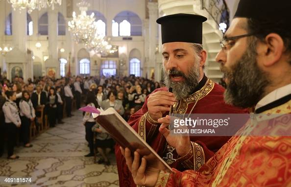 Greek Orthodox priests lead a Good Friday mass at the Meriamiah Church in the Syrian capital Damascus on April 10 2015 AFP PHOTO / LOUAI BESHARA