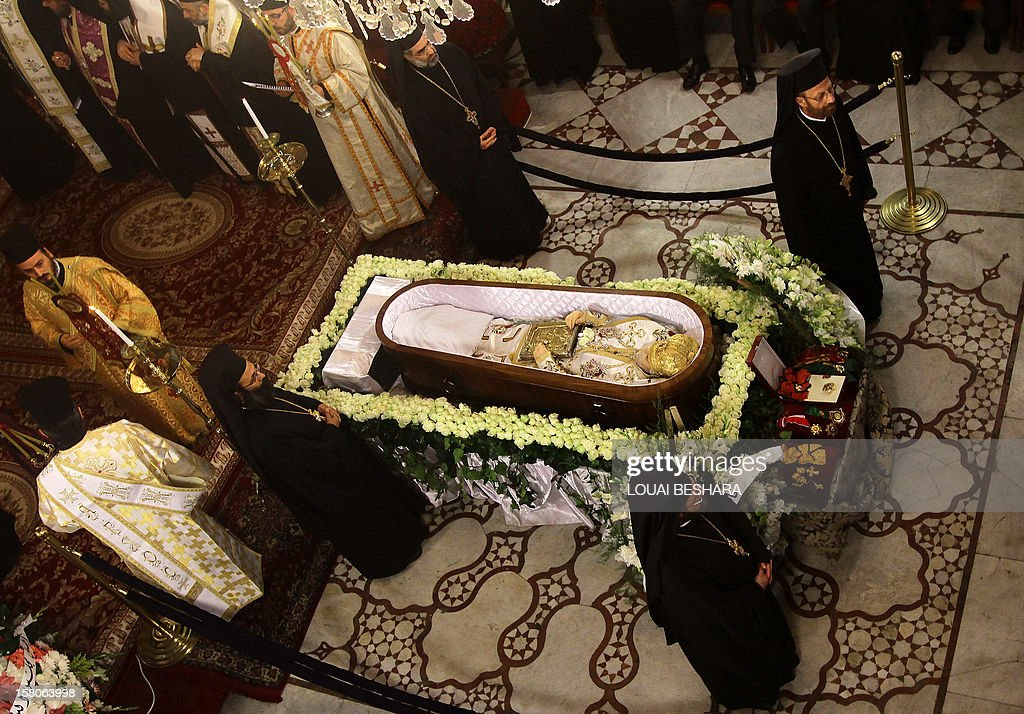 Greek Orthodox priests stand around the coffin of Greek Orthodox patriarch of Syria, Ignatius IV Hazim, during his funeral at the Meriamiah Church in the Syrian capital Damascus on December 10, 2012. The patriarch died of a stroke in the Lebanese capital Beirut on December 5. AFP PHOTO/ LOUAI BESHARA