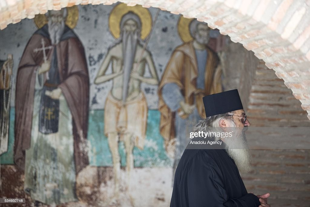 Greek Orthodox priests wait before the visit of The President of Greece, Prokopis Pavlopoulos and President of the Russian Federation, Vladimir Putin in a monastry in Mount Athos, Greece on May 28, 2016.