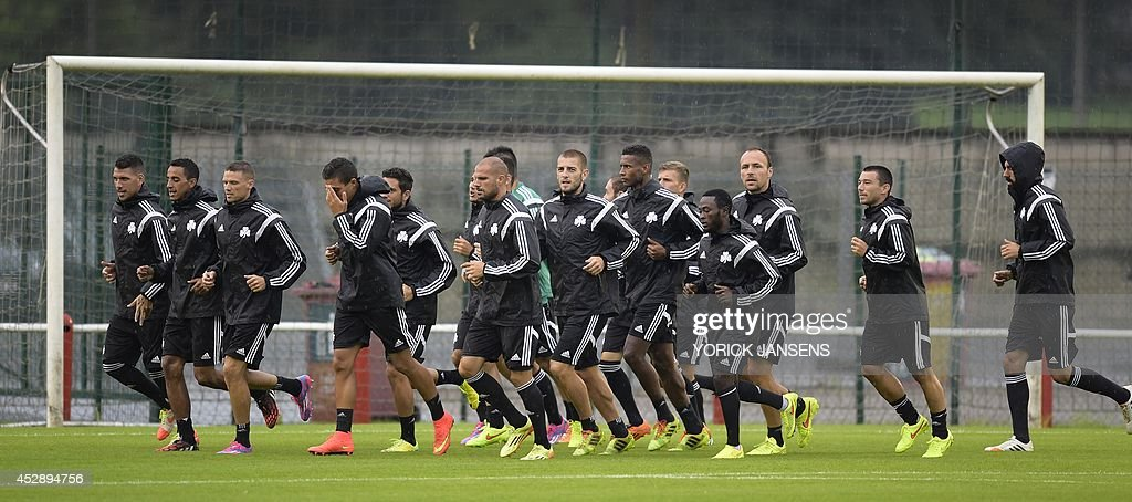 Greek Panathinaikos' football team players warm up during a training session on July 29, 2014, in Liege, a day ahead of their first leg match in the third qualifying round of the UEFA Champions League competition against Belgian first league team Standard de Liege. AFP PHOTO / BELGA / PHOTO YORICK JANSENS Belgium Out