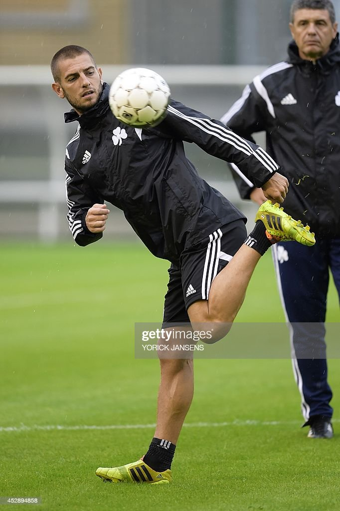 Greek Panathinaikos' football team striker, Croatian Mladen Petric, controls the ball during a training session on July 29, 2014, in Liege, a day ahead of their first leg match in the third qualifying round of the UEFA Champions League competition against Belgian first league team Standard de Liege. AFP PHOTO / BELGA / PHOTO YORICK JANSENS Belgium Out