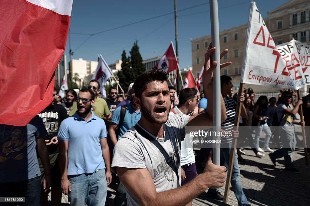 Greek parties, unions and students gather outside the Parliament in Athens during an anti-racism protest on September 25, 2013. Most of the country's mainstream parties called for a large turn-out in the early evening protests, which were sparked by the murder of an anti-fascist musician, allegedly at the hands of a self-confessed neo-Nazi last week.