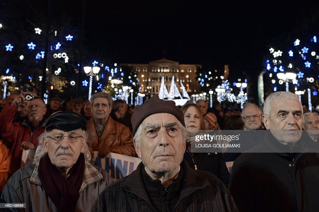 Greek pensioners gather outside the Finance Ministry in central Athens late on December 10 for a nightlong protest against the austerity measures...