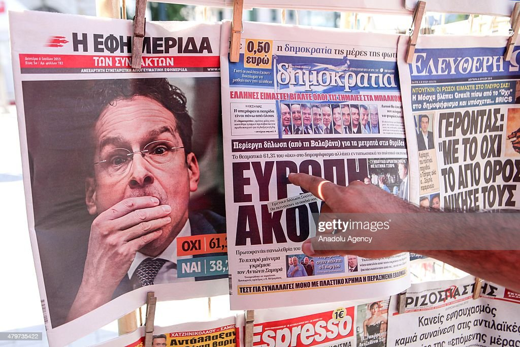 Greek people buy newspapers at the local shops of Athens a day after the Greek bailout referendum on July 06 2015 Greece has voted to reject the...