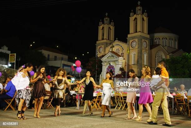 Greek People celebrate the christening of a baby with their traditional dance sirtaci on July 20 2008 in Sianna Rhodes Greece Rhodes is the largest...
