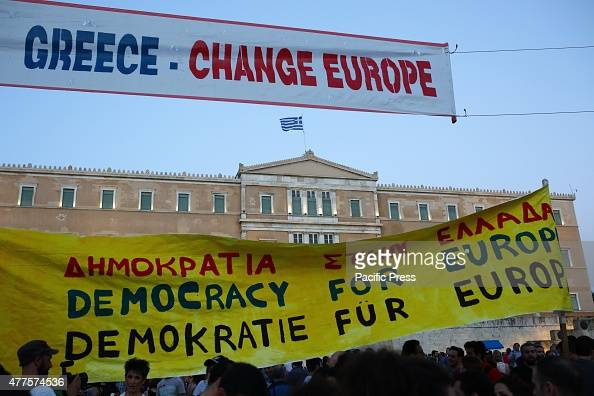 Greek people demonstrate in front of the Greek parliament to demand from the Greek government to not accept any of the proposed austerity measures by...