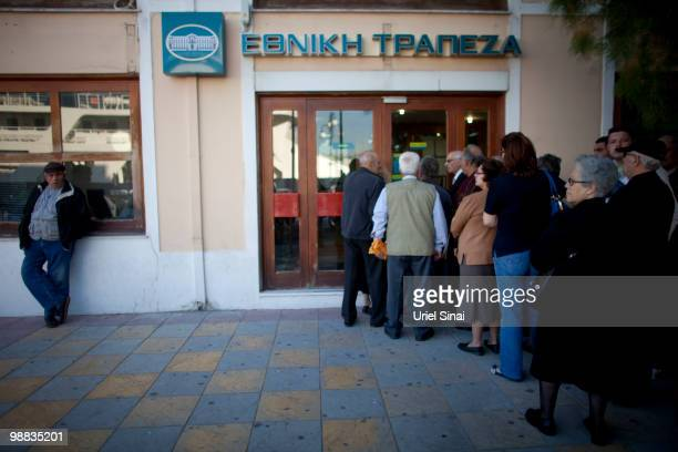 Greek people wait in line for a bank to open on May 4 2010 in Mytilene the capital of the Greek island Lesbos Independent travel agency Sunvil has...