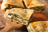 Greek pie with spinach and cheese spanakopita close-up on a table. horizontal