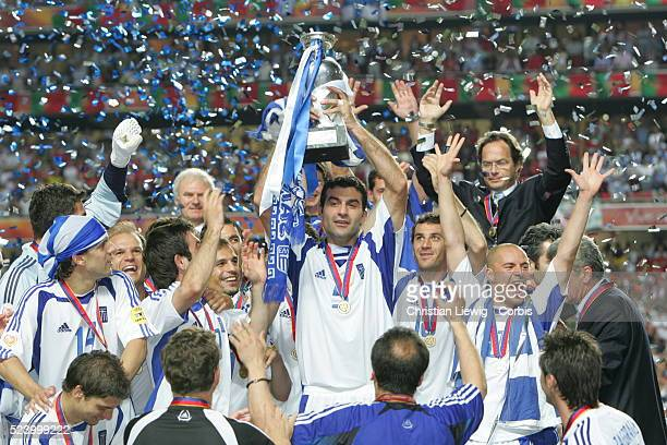Greek players celebrate with the trophy