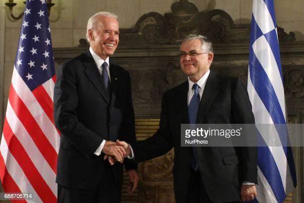 Greek PM Lucas Papademos with US Vice President Joe Biden at Maximos mansion in Athens on December 6 2011