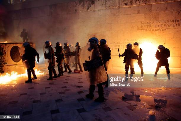 Greek police clash with a protestors in front of the Greek Parliament during a rally against new austerity measures on May 18 2017 in Athens Greece...