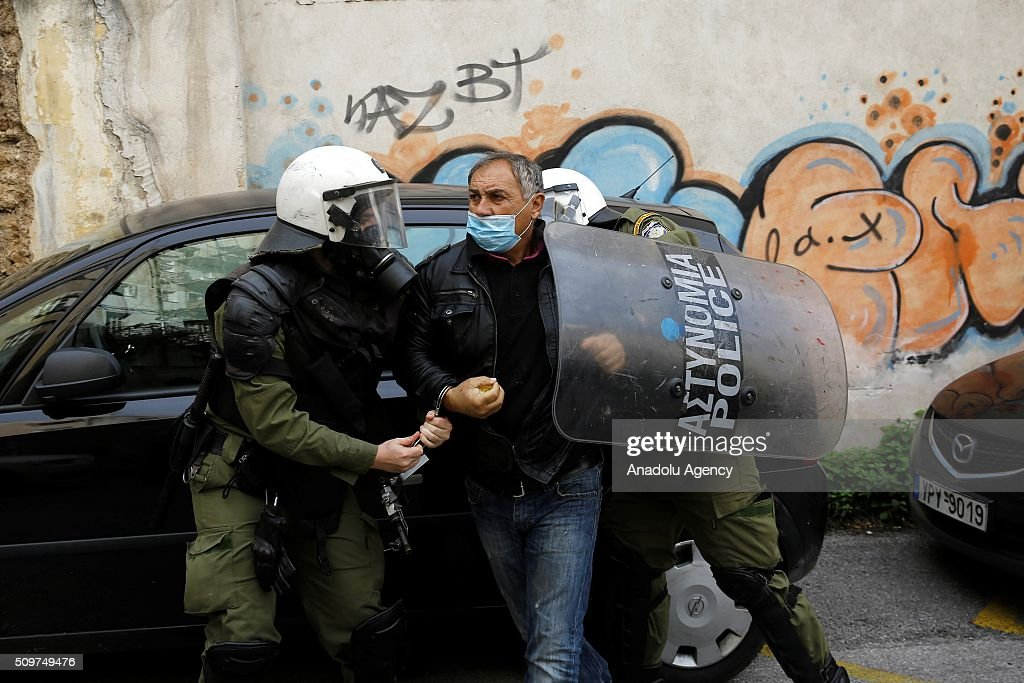Greek Police detains a farmer during clashes outside the Agriculture Ministry in Athens, Greece, on 12 February 2016. Greek farmers organized a demonstration in Athens requesting that the government withdraws its proposed social security and pension reform plan.