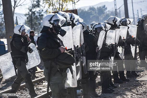 Greek police try to control stranded migrants as they try to cross GreekMacedonian border near the village of Idomeni on December 3 2015 Since the...