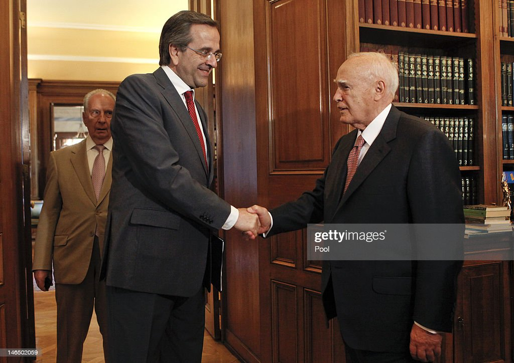 Greek President <a gi-track='captionPersonalityLinkClicked' href=/galleries/search?phrase=Karolos+Papoulias&family=editorial&specificpeople=743016 ng-click='$event.stopPropagation()'>Karolos Papoulias</a> (R) welcomes leader of conservative New Democracy party Antonis Samaras before he receives a mandate to form a government on June 18, 2012 in Athens, Greece. Greece race to form a coalition government by the end of Monday after an election victory by pro-bailout New Democracy party which eased fears of a Greek eurozone exit and brought relief to world markets.
