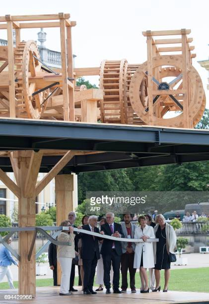 Greek President Prokopis Pavlopoulos and German President FrankWalter Steinmeier stand by the installation 'Mill of Blood' created by Mexican artist...