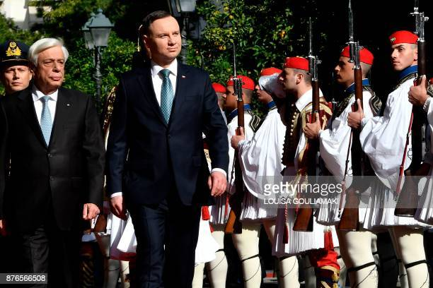 Greek President Prokopis Pavlopoulos and his Polish counterpart Andrzej Duda review the presidental guard during the welcoming ceremony outside the...