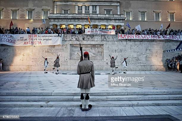 Greek Presidential Guard conducts his ceremonial march as protesters attend an antiausterity progovernment rally in front of the parliament building...