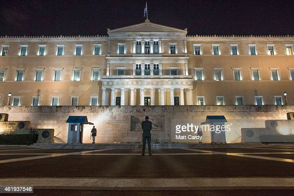 Greek Presidential Guard soldiers perform their duties in front of the the Greek Tomb of the Unknown Soldier beneath the Hellenic Parliament which is...