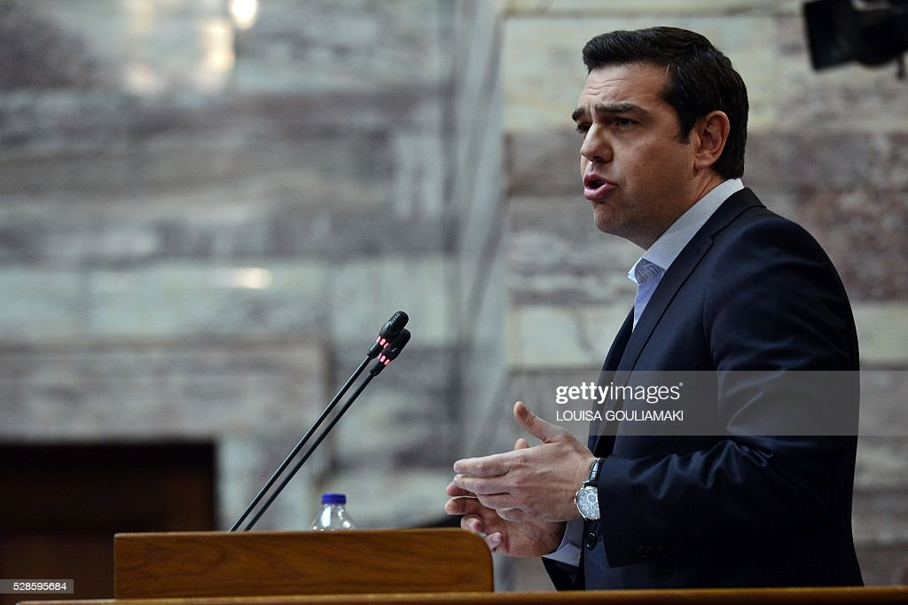 Greek prime minister Alexis Tsipras addresses his lawmakers during his party parliamentary group at the Greek parliament in Athens on May 6, 2016, ahead of the crucial vote at the parliament. The announcement on May 5, 2016 of a general strike came after Greece's parliament said the government's pension and taxation reform bills would be debated and voted on this weekend. / AFP / LOUISA