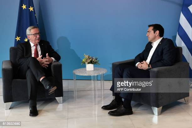 Greek Prime Minister Alexis Tsipras and President of the European Commission JeanClaude Juncker meet ahead of a ceremony to award Juncker with an...