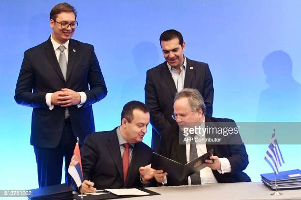 Greek Prime Minister Alexis Tsipras and Serbian President Aleksandar Vucic look at Greek Foreign Minister Nikos Kotzias and First Deputy Prime...