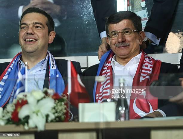 Greek Prime Minister Alexis Tsipras and Turkish Prime Minister Ahmet Davutoglu arrive at Basaksehir Fatih Terim stadium before the international...