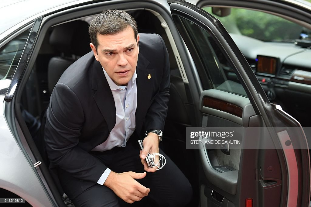 Greek Prime Minister Alexis Tsipras arrives for the second day of an EU - Summit at the EU headquarters in Brussels on June 29, 2016. European Union leaders will on June 29, 2016 assess the damage from Britain's decision to leave the bloc and try to prevent further disintegration, as they meet for the first time without a British representative. / AFP / STEPHANE