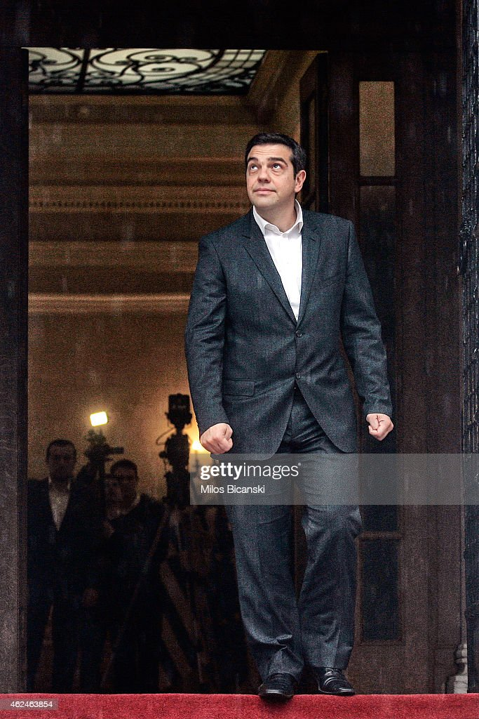 Greek Prime Minister <a gi-track='captionPersonalityLinkClicked' href=/galleries/search?phrase=Alexis+Tsipras&family=editorial&specificpeople=6592450 ng-click='$event.stopPropagation()'>Alexis Tsipras</a> checks the weather as he awaits European Parliament President Martin Schulz at his office prior to their meeting on January 29, 2015 in central Athens, Greece. The radical left party Syriza won the snap Greek general election and asked the right-wing Independent Greek party to form an anti-austerity coalition.