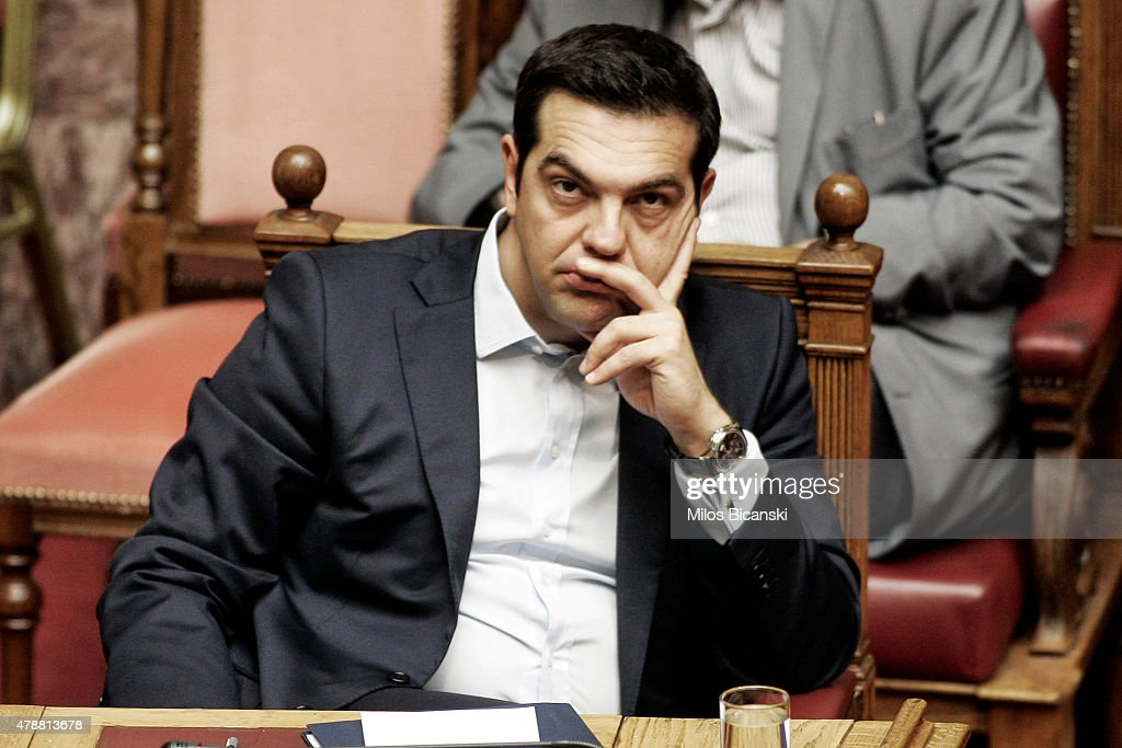 Greek Prime Minister <a gi-track='captionPersonalityLinkClicked' href=/galleries/search?phrase=Alexis+Tsipras&family=editorial&specificpeople=6592450 ng-click='$event.stopPropagation()'>Alexis Tsipras</a> during a parliamentary session in Athens, Greece June 28, 2015 . Greece's fraught bailout talks with its creditors took a dramatic turn early Saturday, with the radical left government announcing a referendum in just over a week on the latest proposed deal .