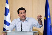 Greek Prime Minister Alexis Tsipras gestures as he speaks during a press conference at the Greek Ministry of Infrastructure Transport and Networks in...