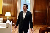 Greek Prime Minister Alexis Tsipras gestures as he waits for UN refugee agency chief prior to a meeting at his office in Athens on February 24 2016...