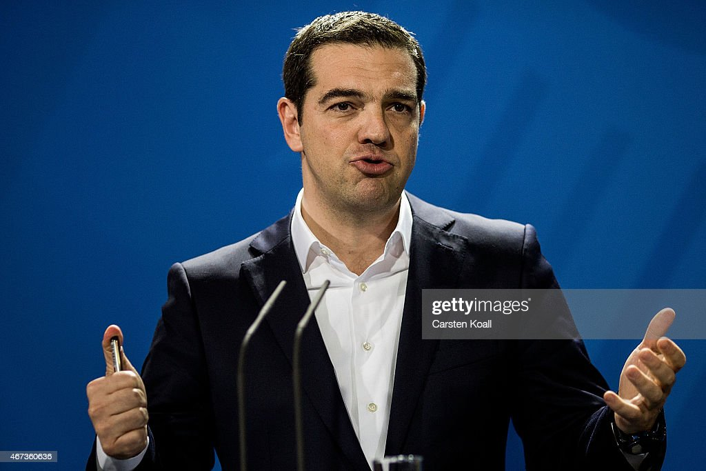 Greek Prime Minister Alexis Tsipras gestures while he and German Chancellor Angela Merkel speak to the media following talks at the Chancellery on March 23, 2015 in Berlin, Germany. The two leaders are meeting as relations between the Tsipras government and Germany have soured amidst contrary views between the two countries on how Greece can best work itself out of its current economic morass.