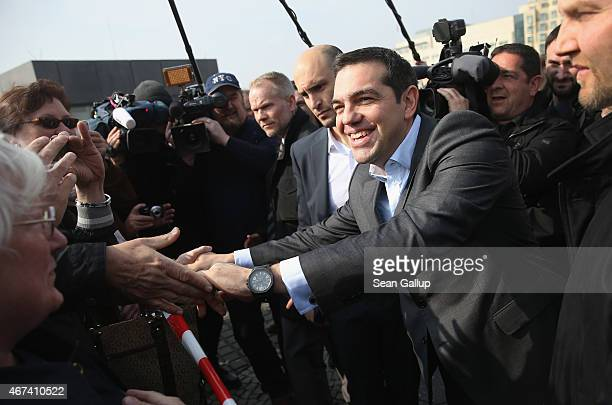 Greek Prime Minister Alexis Tsipras greets onlookers after visiting the Memorial to the Murdered Jews of Europe also called the Holocaust Memorial on...