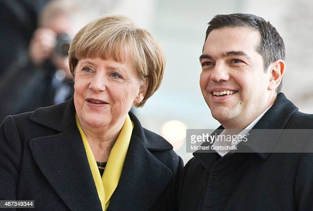 Greek Prime Minister Alexis Tsipras is greeted by German Chancellor Angela Merkel ahead of talks at the German Chancellery on March 23 2015 in Berlin...