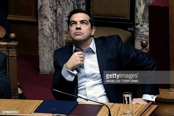 Greek Prime Minister Alexis Tsipras is seen during a parliamentary session in Athens on December 10 2016 / AFP / Angelos Tzortzinis