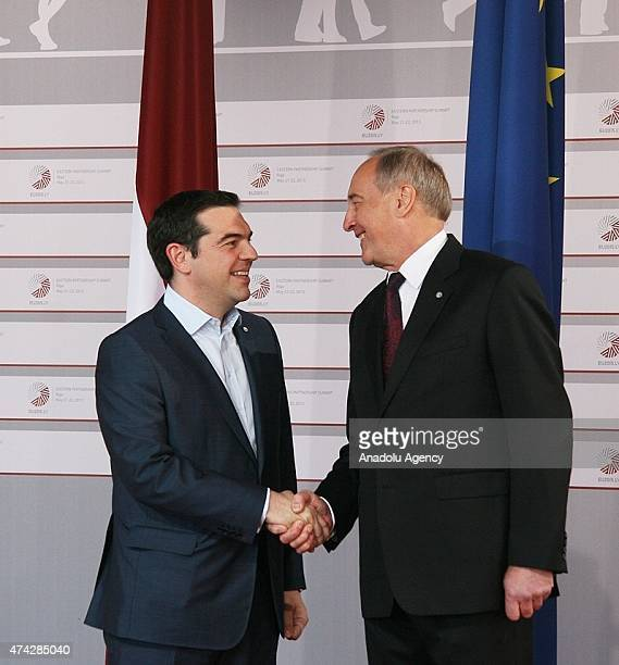 Greek Prime Minister Alexis Tsipras is welcomed by Latvian President Andris Berzins as he arrives at the House of the Blackhead for a dinner at the...