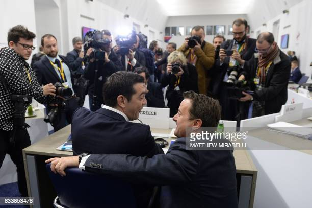 Greek Prime Minister Alexis Tsipras jokes with Prime Minister of Luxembourg Xavier Bettel during an Informal summit of EU heads of state or...