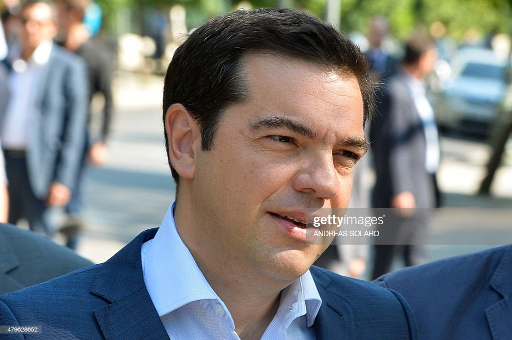 Greek Prime Minister Alexis Tsipras leaves his office before his meeting with the Greek president and Greek political leaders in Athens on July 6...