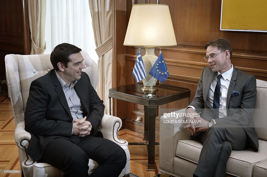 Greek prime minister <a gi-track='captionPersonalityLinkClicked' href=/galleries/search?phrase=Alexis+Tsipras&family=editorial&specificpeople=6592450 ng-click='$event.stopPropagation()'>Alexis Tsipras</a> (L) listens to <a gi-track='captionPersonalityLinkClicked' href=/galleries/search?phrase=Jyrki+Katainen&family=editorial&specificpeople=3014648 ng-click='$event.stopPropagation()'>Jyrki Katainen</a>, European Commission Vice-president for Jobs, Growth, Investment and Competitiveness during their meeting in Athens on April 24, 2015. European ministers on Friday heaped pressure on Greece to speed up negotiations to unblock critically needed bailout funds and avert a dangerous default and cash crunch as time for Athens runs out.